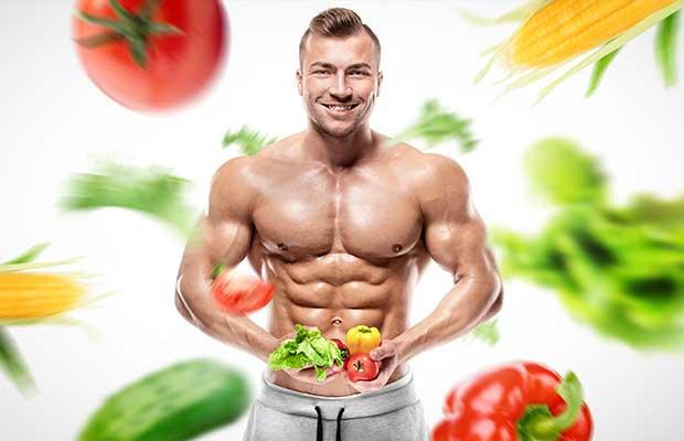 Bodybuilder επιλέγει λαχανικά για διατροφή